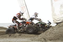 Vierlingen bij motocrossras Stock Foto's