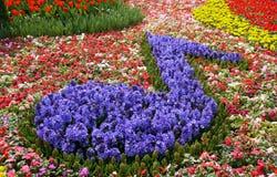 Viertelanmerkung gebildet von den Blumen Lizenzfreie Stockfotos