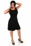 Vierzig Einjahresfrau am Telefon lizenzfreies stockfoto