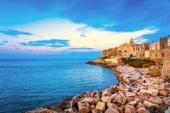 Vieste town on the rocks, Gargano, Apulia, Italy. Stock Photos