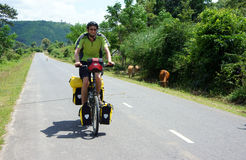Traveller ride bicycle on the road conect Dalat to Royalty Free Stock Photography