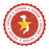 Vietnam översikt och flagga i den rubber stämpeln för tappning av Royaltyfri Foto