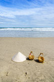 Vietnam Beach. Conical Hat or Traditional hat {Non La} and rattan or bamboo frame {to hold loads at the end of a carrying pole} in Danang beach, Vietnam Royalty Free Stock Photos