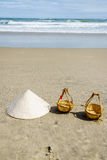 Vietnam Beach. Conical Hat or Traditional hat {Non La} and rattan or bamboo frame {to hold loads at the end of a carrying pole} in Danang beach, Vietnam Stock Photography