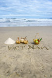 Vietnam Beach. Conical Hat or Traditional hat {Non La} and rattan or bamboo frame {to hold loads at the end of a carrying pole and Vietnam written on the sand Stock Photo