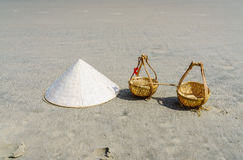 Vietnam Beach. Conical Hat or Traditional hat {Non La} and rattan or bamboo frame {to hold loads at the end of a carrying pole} in Danang beach, Vietnam Stock Photos