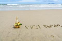 Vietnam Beach. Vietnam written on the sand with fruit basket in Danang beach, Vietnam Royalty Free Stock Image