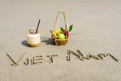 Vietnam Beach. Vietnam written on the sand with fruit basket and a coconut in Danang beach, Vietnam Stock Photo