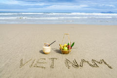 Vietnam Beach. Vietnam written on the sand with fruit basket and a coconut in Danang beach, Vietnam Stock Images