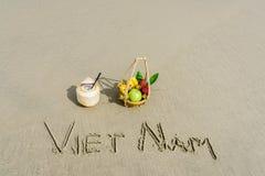 Vietnam Beach. Vietnam written on the sand with fruit basket and a coconut in Danang beach, Vietnam Stock Photos