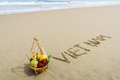 Vietnam Beach. Vietnam written on the sand with fruit basket in Danang beach, Vietnam Royalty Free Stock Photo