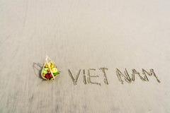 Vietnam Beach. Vietnam written on the sand with fruit basket in Danang beach, Vietnam Stock Photo