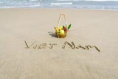 Vietnam Beach. Vietnam written on the sand with fruit basket in Danang beach, Vietnam Stock Photography