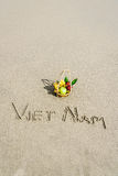 Vietnam Beach. Vietnam written on the sand with fruit basket in Danang beach, Vietnam Stock Photos