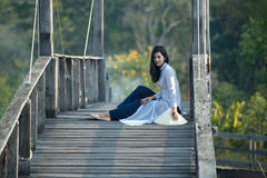 VIETNAM Beautiful women in Ao Dai Vietnam Traditional dress sitting on the wooden bridge this is a Vietnam culture royalty free stock photos