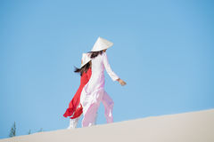Vietnam. Beautiful women with vietnam culture traditional ,vintage style,Ao Dai traditional,vietnamese women in Ao Dai traditional at white sand beach stock photo
