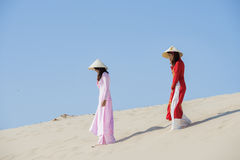 Vietnam. Beautiful women with vietnam culture traditional ,vintage style,Ao Dai traditional,vietnamese women in Ao Dai traditional at white sand beach stock image