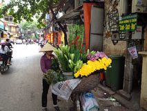 Vietnam-Blumen-Verkäufer stockfotografie