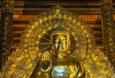 Vietnam Chua Bai Dinh Pagoda: Frontal Close up of Giant Golden B Royalty Free Stock Images