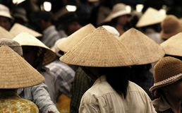 Vietnam conic hats. A typical view of Vietnam's market morning : women with conic hats Stock Photo
