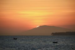 Vietnam Dreaming. The sun sets on another day over the fishing boats of Vietnam Stock Images