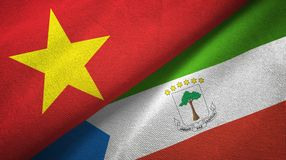 Vietnam and Equatorial Guinea two flags textile cloth, fabric texture. Vietnam and Equatorial Guinea two folded flags together stock illustration