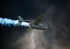 Vietnam era airplane flying through wall of smoke Royalty Free Stock Image