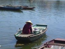 Vietnam farmer boat. Vietnam farmer paddling on boat Royalty Free Stock Images