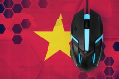 Vietnam flag and computer mouse. Concept of country representing e-sports team. Vietnam flag and modern backlit computer mouse. Concept of country representing e stock photos