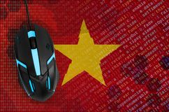 Vietnam flag and computer mouse. Digital threat, illegal actions on the Internet. Vietnam flag and modern backlit computer mouse. The concept of digital threat royalty free stock photo
