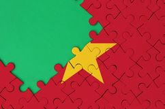 Vietnam flag is depicted on a completed jigsaw puzzle with free green copy space on the left side.  royalty free stock photography