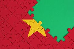Vietnam flag is depicted on a completed jigsaw puzzle with free green copy space on the right side.  stock photography