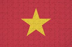 Vietnam flag is depicted on a folded puzzle royalty free stock photos
