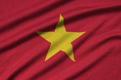 Vietnam flag is depicted on a sports cloth fabric with many folds. Sport team banner. Vietnam flag is depicted on a sports cloth fabric with many folds. Sport stock photo