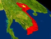 Vietnam with flag on Earth Stock Photography