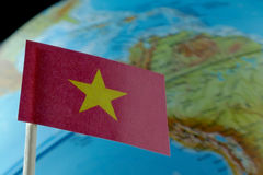 Vietnam flag with a globe map as a background. Macro royalty free stock image
