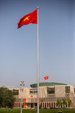 Vietnam flag with the Government Headquarters behind Royalty Free Stock Photos