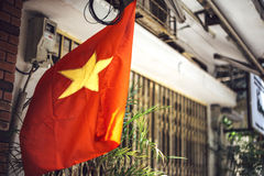 Vietnam flag hanging in the street Royalty Free Stock Photo