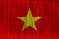 Vietnam flag painted on old wood plank. Patriotic background. National flag of Vietnam royalty free stock image