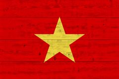 Vietnam flag painted on old wood plank. Patriotic background. National flag of Vietnam stock photo