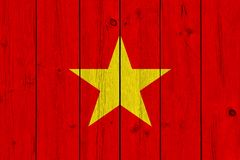 Vietnam flag painted on old wood plank. Patriotic background. National flag of Vietnam stock photos
