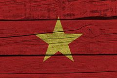 Vietnam flag painted on old wood plank. Patriotic background. National flag of Vietnam stock illustration