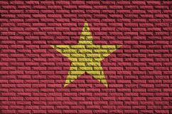 Vietnam flag is painted onto an old brick wall vector illustration