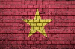 Vietnam flag is painted onto an old brick wall stock photography