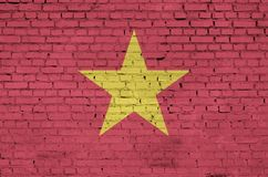 Vietnam flag is painted onto an old brick wall stock photo
