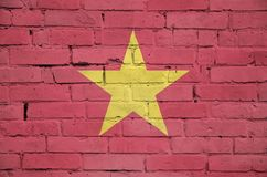 Vietnam flag is painted onto an old brick wall stock photos