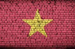 Vietnam flag is painted onto an old brick wall royalty free illustration