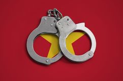 Vietnam flag and police handcuffs. The concept of observance of the law in the country and protection from crime.  stock image