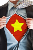 Vietnam flag on shirt. Business man showing Vietnam flag shirt stock image