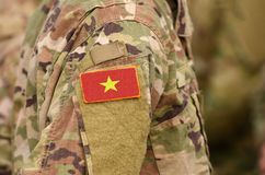 Vietnam flag on soldiers arm. Vietnam troops collage.  royalty free stock images